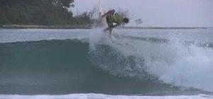 Perform a kerrupt flip on a surfboard