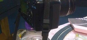 Camera tripod with camera phone attachment
