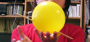 The Trick to Stabbing a Balloon Without Popping It