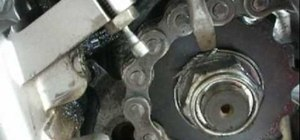 Replace the chain and sprockets on a Suzuki SV650 motorcycle