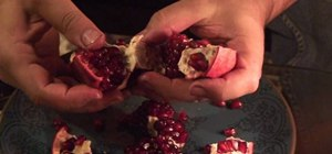 Neatly cut into a pomegranate to get the seeds