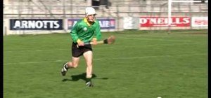 Practice the ground strike on the run skill in hurling