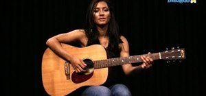 """Play """"Money"""" by Pink Floyd on an acoustic guitar"""