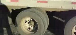 Slide trailer axles to distribute weight