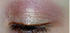 Apply light pink and gold eyeshadow