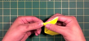 Create a sitting origami bunny rabbit