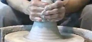 Throw clay on a wheel