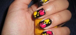 Paint a funky pink & yellow paw print nail manicure