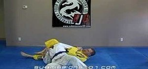 Escape a Jiu Jitsu scarf hold by hooking the head