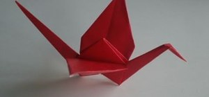 Make a paper crane out of origami paper