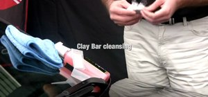 Use an auto clay bar to clean paint contamination