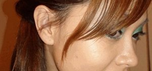 Do a simple & quick side ponytail with a twist