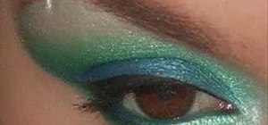 Apply bright blue and green eyeshadow