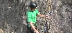 Big wall rock climb with a basic ascender setup