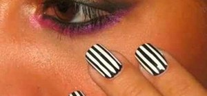 Apply a black and white striped nail manicure