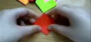 Fold hearts from square sheets of paper with origami