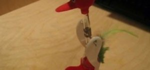 Analyze the drinking bird toy