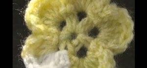 Make a five petaled crochet flower for right handers
