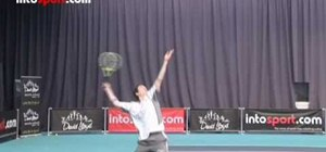 Use slice serves to serve with spin in tennis