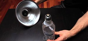 Change a broken lightbulb using a water bottle