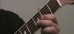 "Play ""Day Tripper"" by the Beatles on guitar"