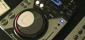 Mix a slow track to a faster one on a DJ mixer