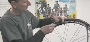 Change a bicycle tire & replace the inner tube