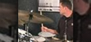 Play a shuffle on the drums