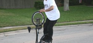 Do a hitchhiker trick on your BMX bike