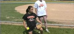Practice a knee drill for pitching in softball