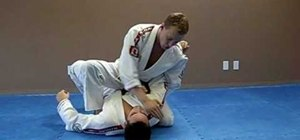 Do a Jiu Jitsu wrapping shoulder lock