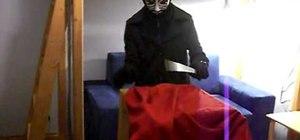 "Perform the ""levitating scarf"" magic trick"