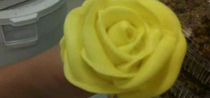 Make a yellow rose out of icing for cake decorating