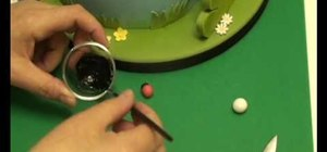 Make miniature sugarpaste bumble bees and ladybugs