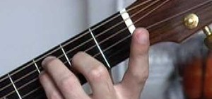 Play E shape barré chords on the guitar