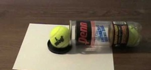 Make a DIY tennis ball cannon out of a soda can and rubber bands