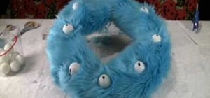 Create a fun and kooky fuzzy monster eyeball Halloween wreath