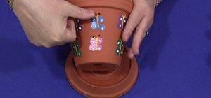 Make a thumbprint butterfly clay pot with your kids