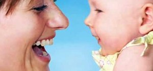 Encourage a four-month-old baby to vocalize