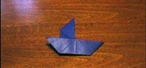 Fold a simple origami sailboat