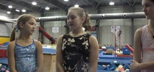 Perform tricks on a balance beam in gymnastics