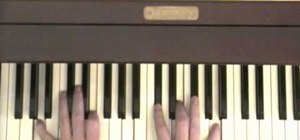 "Play ""Hey Bulldog"" by the Beatles on the piano"