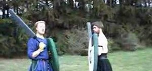 Hold a boffer sword correctly and attack an opponents foam shield
