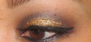 Create a dazzling homecoming makeup look with gold and black