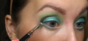 Create an aqua green eye makeup look