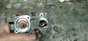 Clean the throttle body on a Saturn S-series car