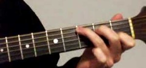 Play a strum pattern in 6/8 on the acoustic guitar