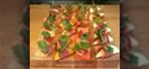 Make fruit and serrano ham canapes