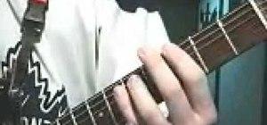 Play heavy metal power chords on guitar