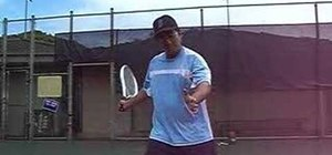 Grip the tennis raquet when returning a serve